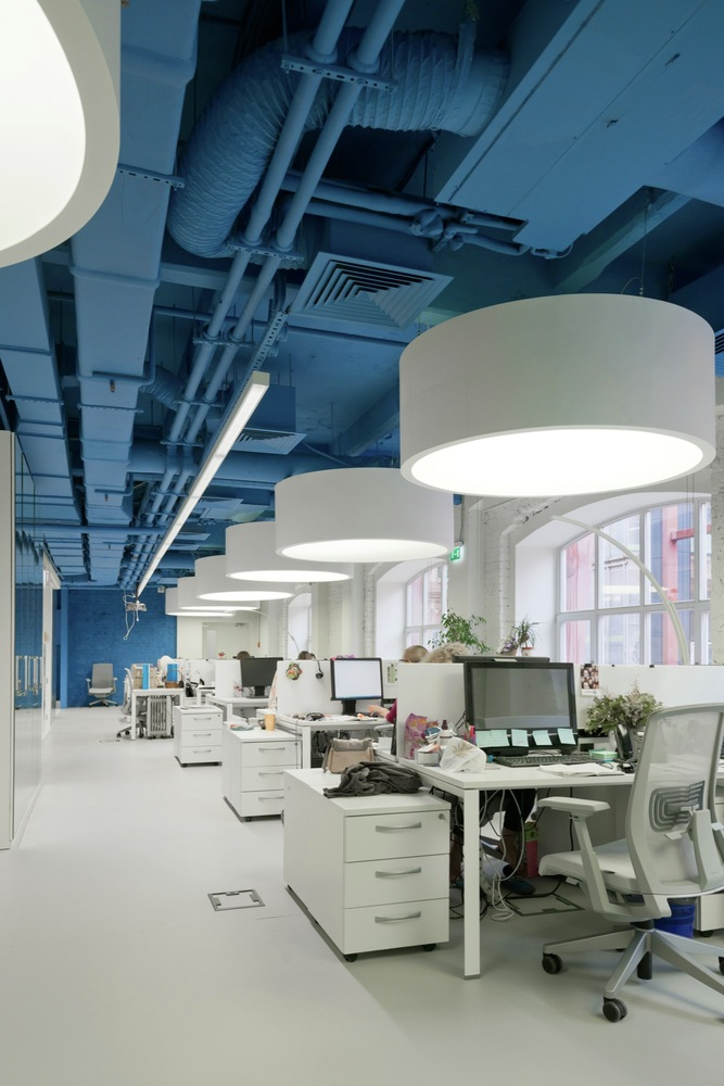 office space lighting. Open Plan Office Space With Exposed Blue Ceiling Lighting